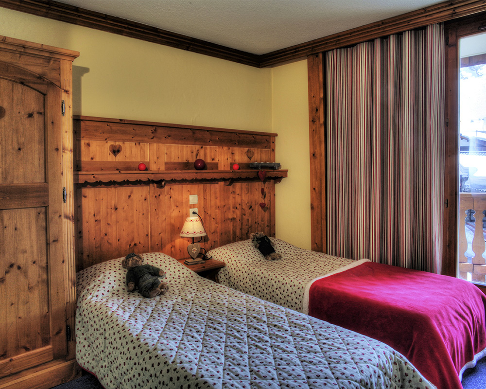 Image of a twin bedroom at the residence