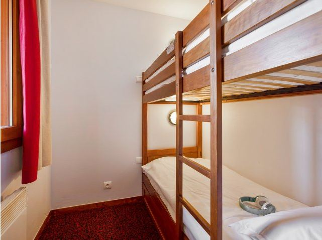 Image of the wooden bunkbeds within an apartment at Residence Le Mont Soleil La Plagne