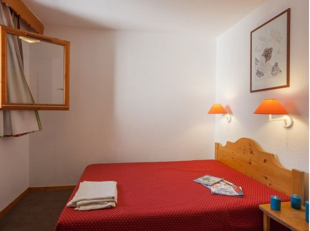 Image of a double bedroom with the apartment at Residence Les Valmonts with the window open