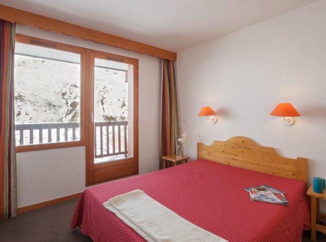 Image of a double bedroom within an apartment in Residence Les Valmonts with a balcony