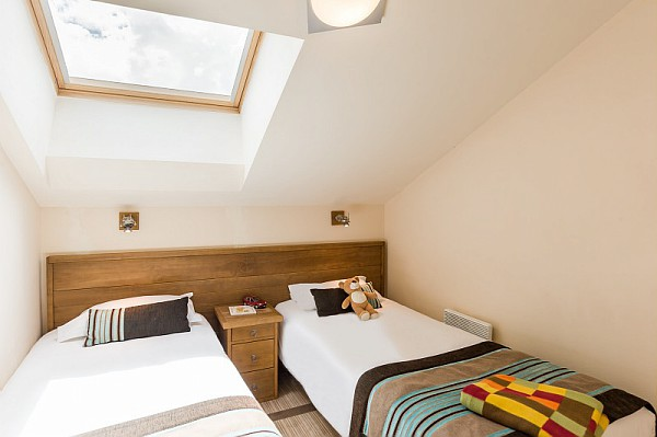 Twin bedroom at residence terrasses d'eos flaine