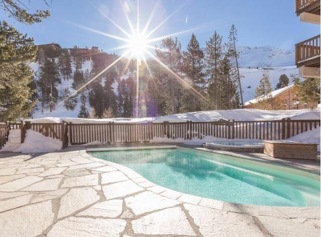 Outdoor swimming pool at Arc 1950 le Village Hameau du Glacier