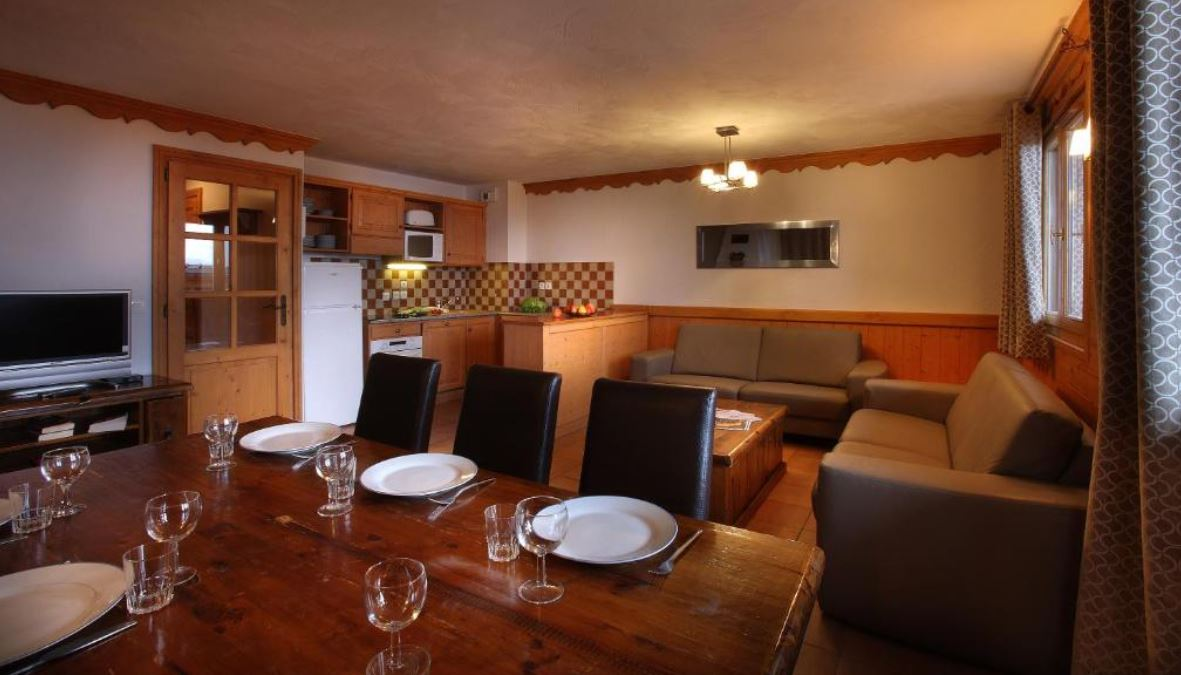 This is an image of the living and dining area in one of the apartments at Chalet Des Neiges Plein Sud