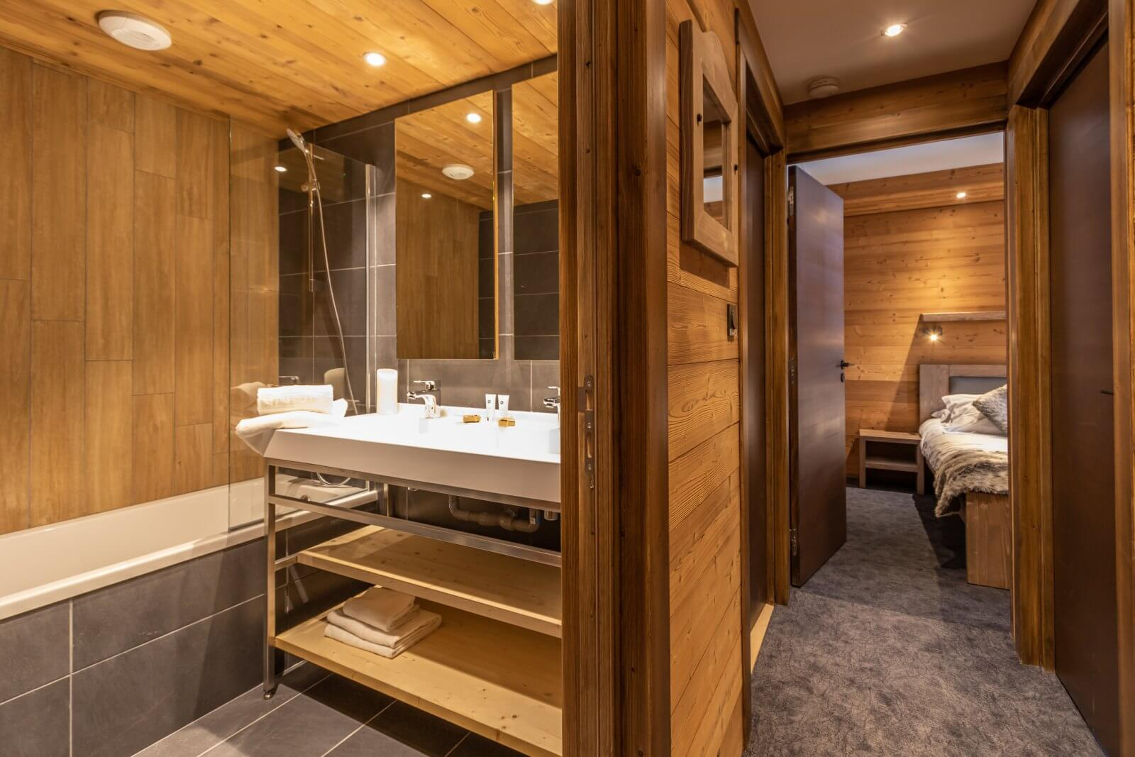 A bathroom with a bath in one of the apartments