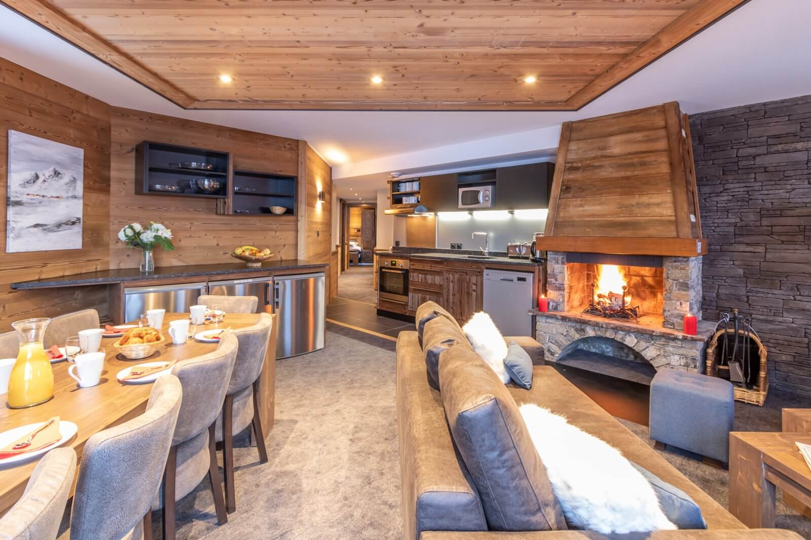 An image of the living area with a stone fireplace