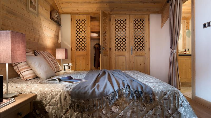 A double bed in one of the apartments