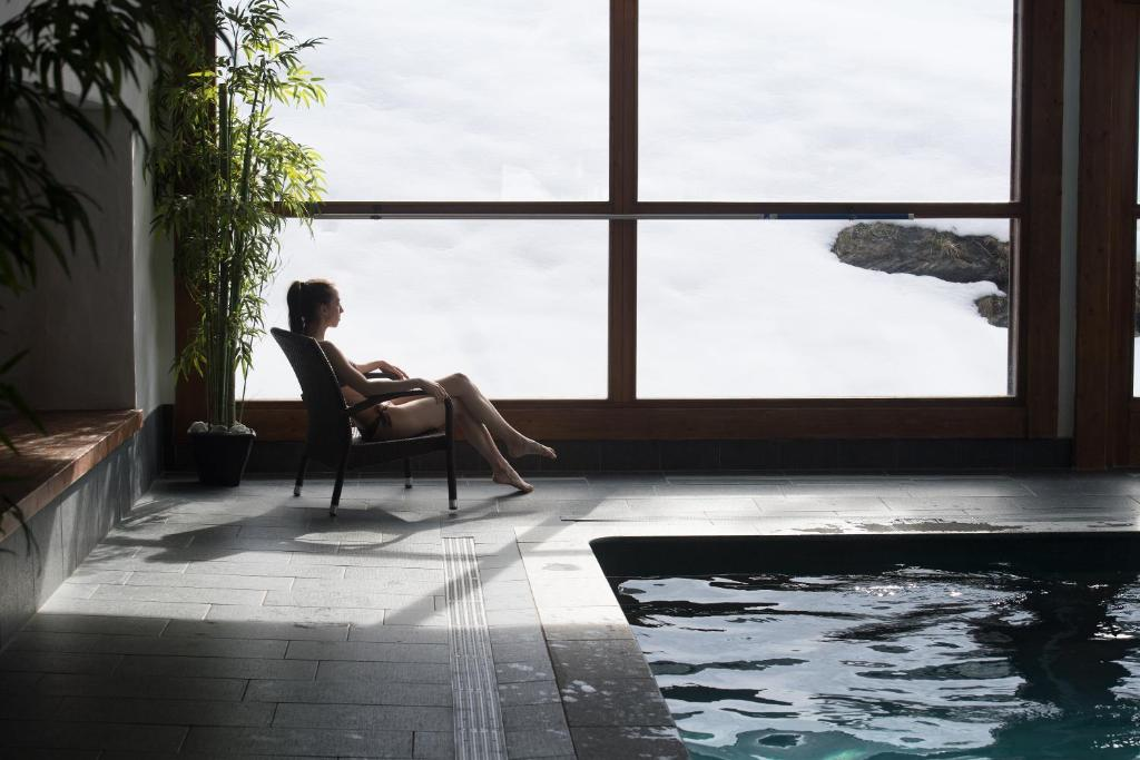 An image of a woman enjoying the pool area