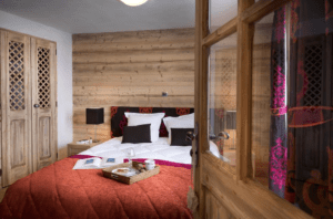 An image of a double bed in one of the bedrooms