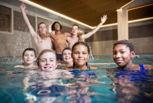 An image of children enjoying the indoor swimming pool